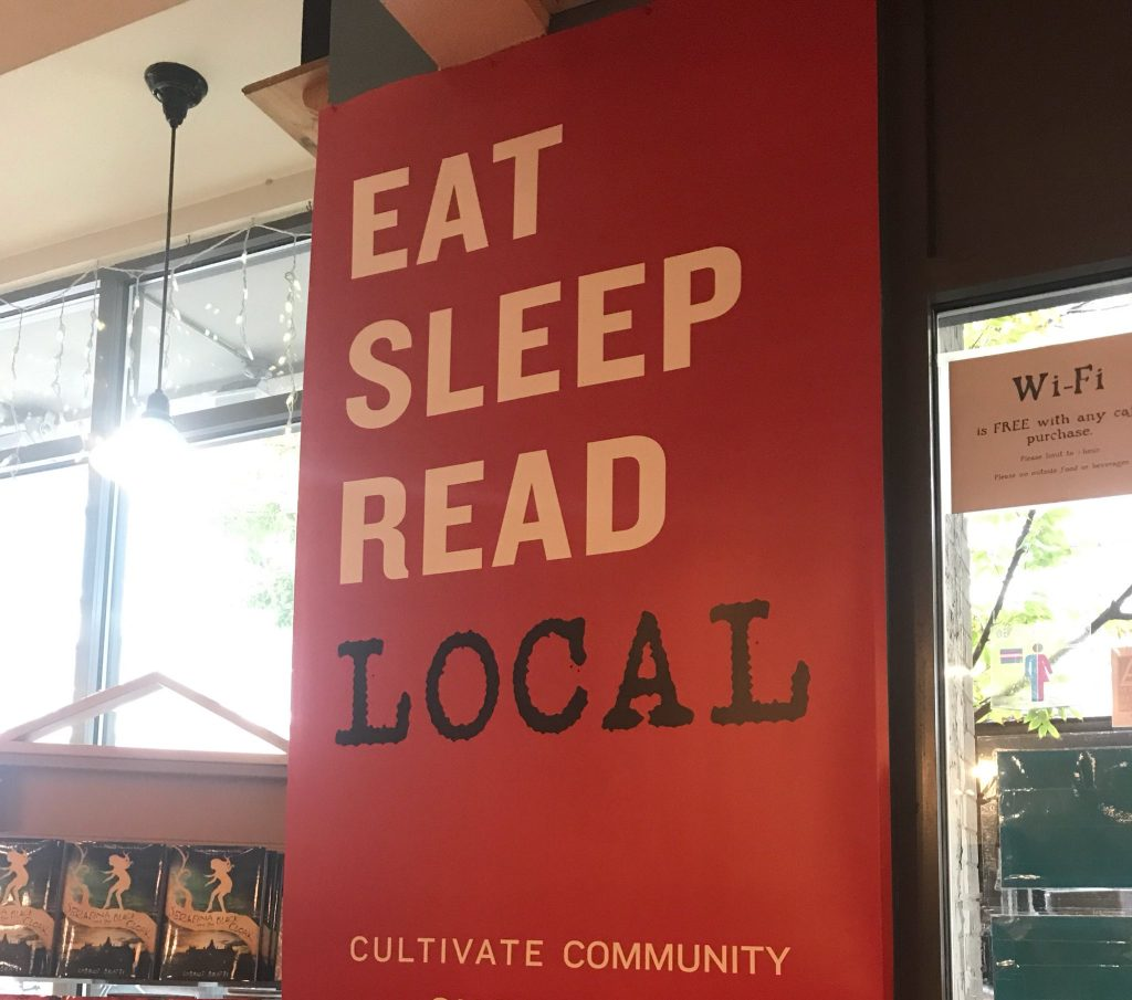 A sign that reads 'Eat Sleep Read Local'