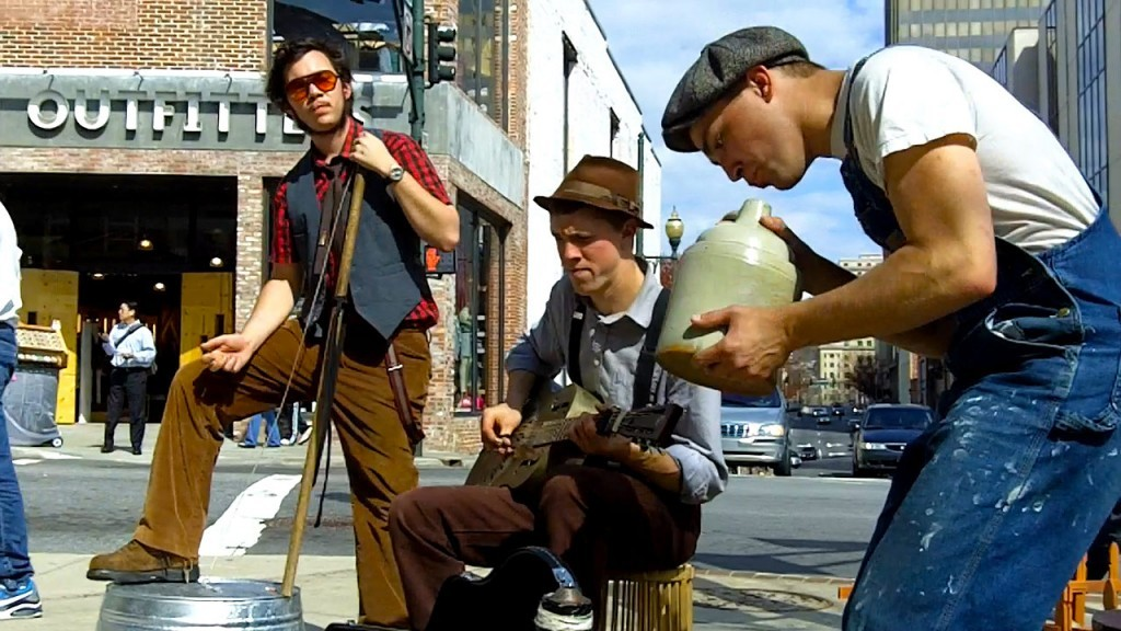 Three men busking on the streets of Asheville