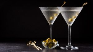 Two martinis against a black background